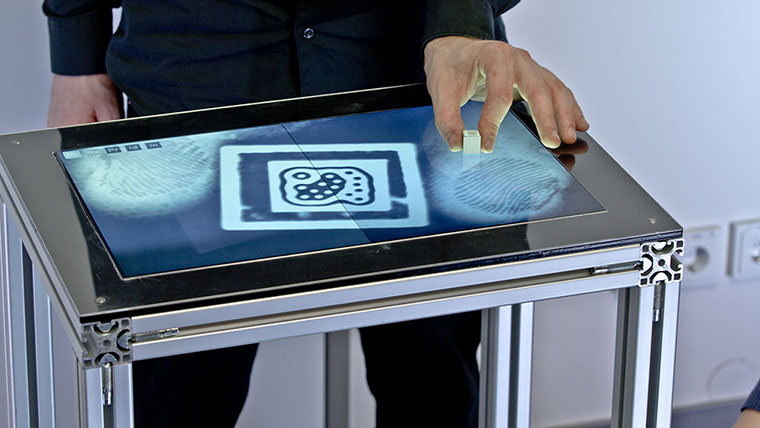 Fiberio also detects hovering objects, such as hands, as well as tangible objects by recognizing fiducial markers