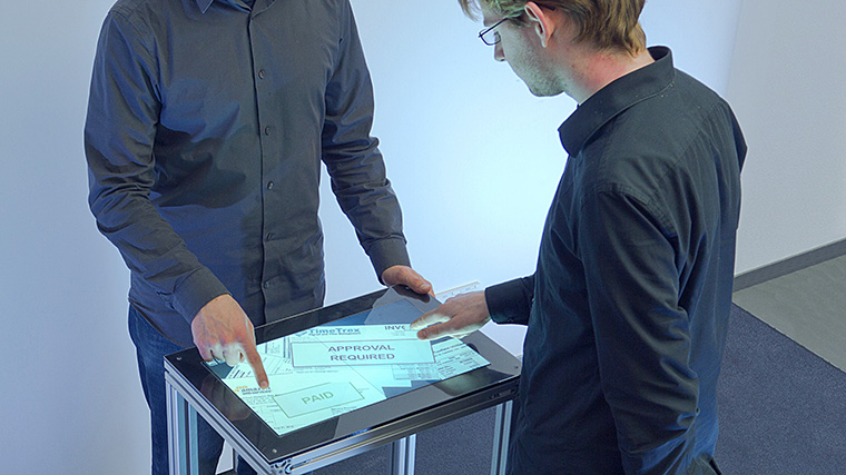 Fiberio: A Touchscreen that Senses Fingerprints and Identifies Users Biometrically During Each Touch